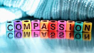 Compassion word spelled out colorful abc