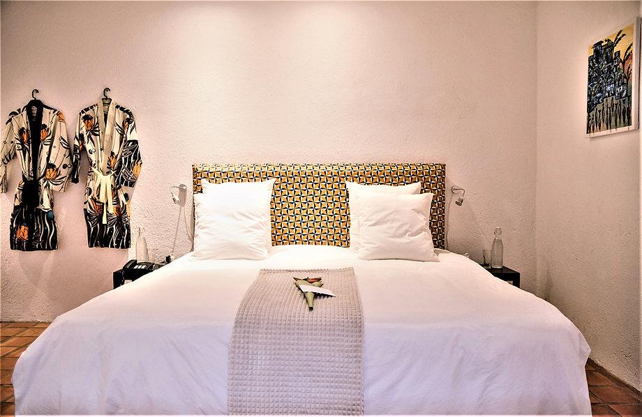 Bedroom met bathrobes.jpg