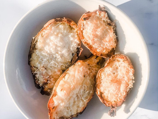 Baked Potato Skins with Pulled Ham and Grated Cheese