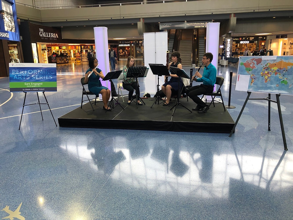 Theresa Abalos, flute, performs with Ears Engaged at the Pittsburgh International Airport.