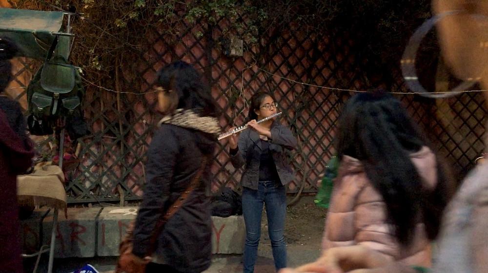 Theresa Abalos, flutist, busks in an artisan fair in Córdoba, Argentina.