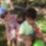 Children on a Rocking Horse