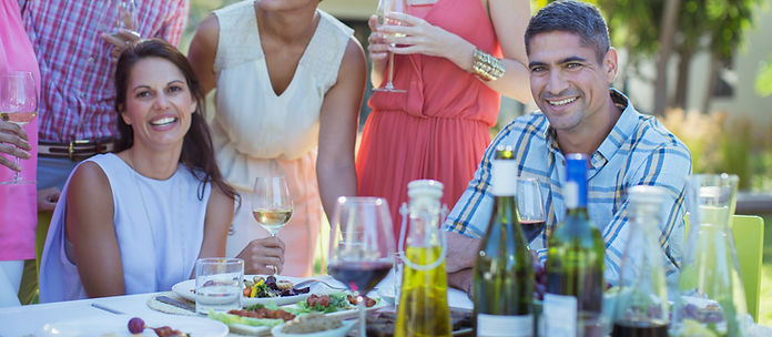 Social gathering with wine and food.