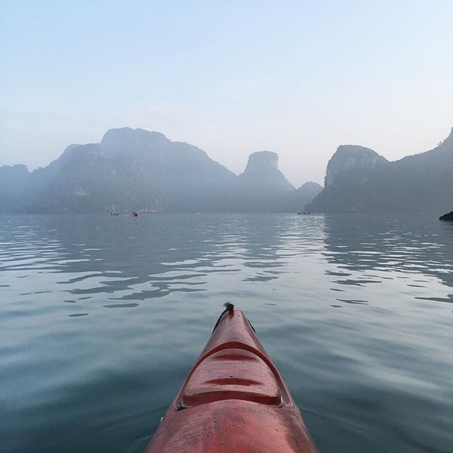 Kayaking in the morning during sunrise in Halong Bay #traveladventures #halongbay #vietnam