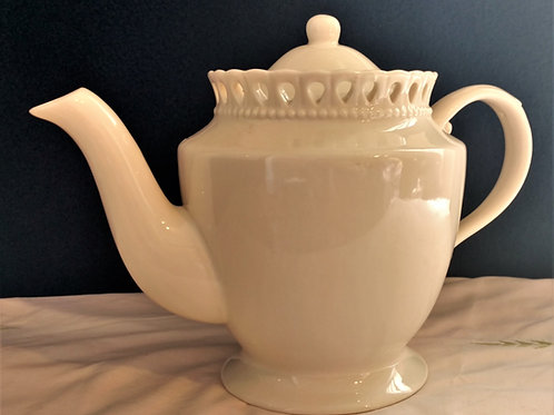 Lace Rimmed Ivory Teapot