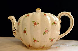 Delicate Rose Gold Trimmed Teapot $20.00