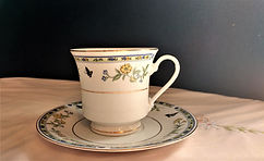 Truly Tasteful Fine China Teacup with Sa
