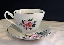 Rose Teacup with Saucer $5.00.jpg