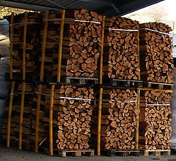 logs stacked on 1m3 pallets