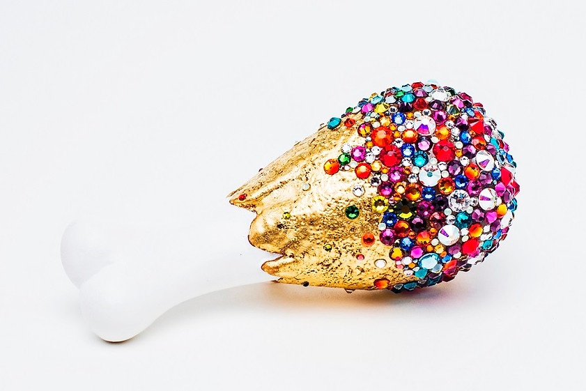 "Reka Lorincz -  ""Too Much is Not Enough"" (bone) brooch -  gold plated copper, plastic, gold foil, swarovski crystal"