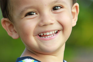 close up portrait of mixed race kid smil
