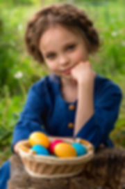 Little smiling child girl with Easter co