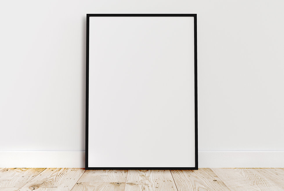 Empty thin black frame on light wooden f