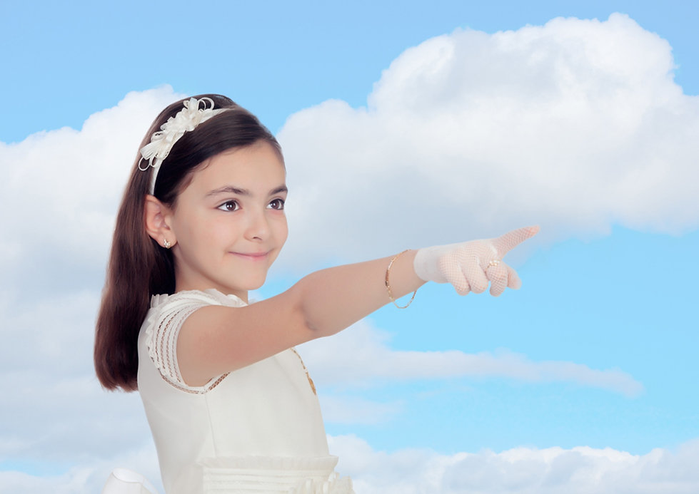 Adorable little girl dressed in communion with a blue sky of background_edited_edited.jpg