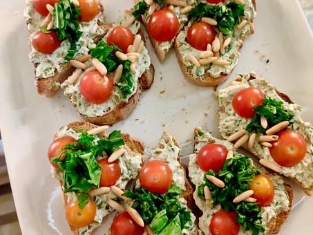 Creamed olives, tomato, and arugula  artisanal toast