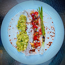 Spicy grilled fish with heirloom tomato salsa