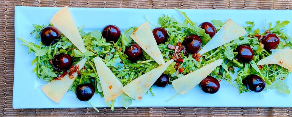 Arugula with cherries, sheep's milk cheese and sherry vinaigrette
