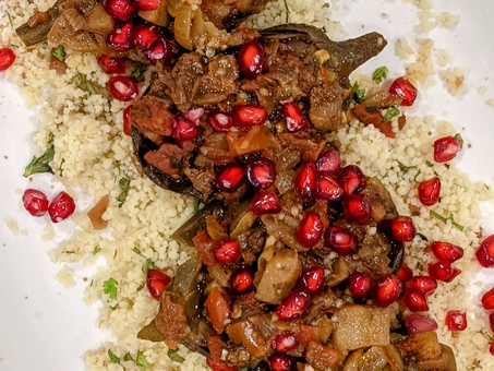 Imam biyaldi or Turkish twice cooked eggplant with preserved lemon scented couscous