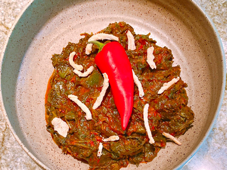 Water spinach with roasted tomato sambal