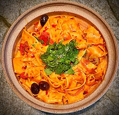 Pappardelle with rose harissa, black olives, and capers