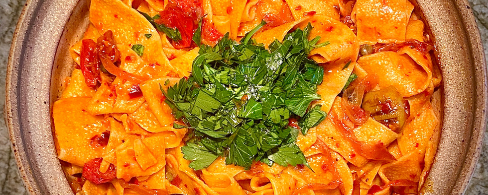 Pappardelle with rose harissa, black oli