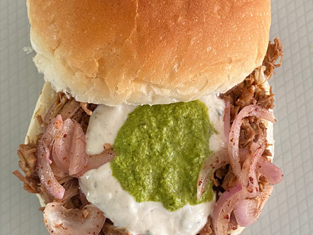 Pulled lamb/goat shoulder with pickled onions and sumac, tzatziki sauce, and green schug