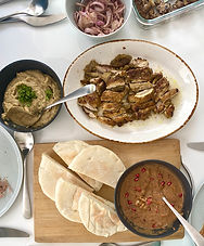 Shawarma chicken with warm chickpea purée and sumac onions