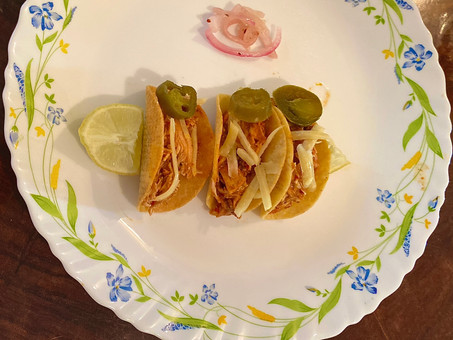 Chicken tacos Coloradito with roasted arbor chili salsa