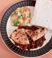 Achiote-marinated chicken breasts with black beans and mango salsa