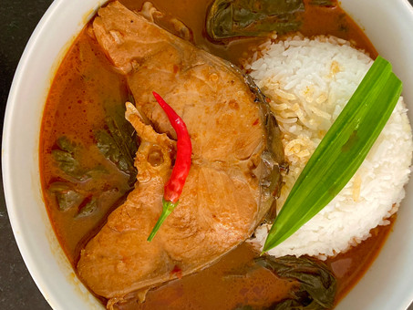 Sweet-and-sour Thai curry of water spinach and fish, served with pandanus rice