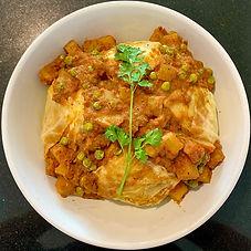 Spicy cabbage roast (Band gobi musallam)