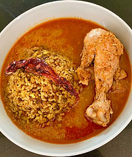 Karwar chicken curry-country style, served with mung dal kichidi