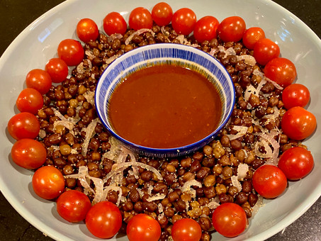 Black chickpeas with white poppy seeds and red onions