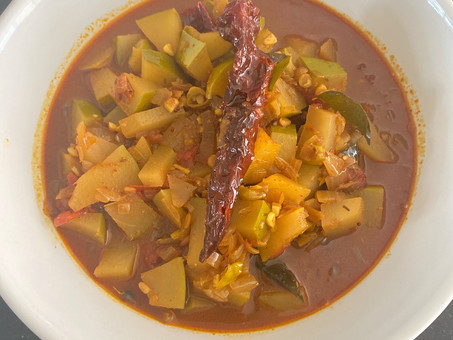 Andhra-style spicy raw mango in a sweet tamarind sauce