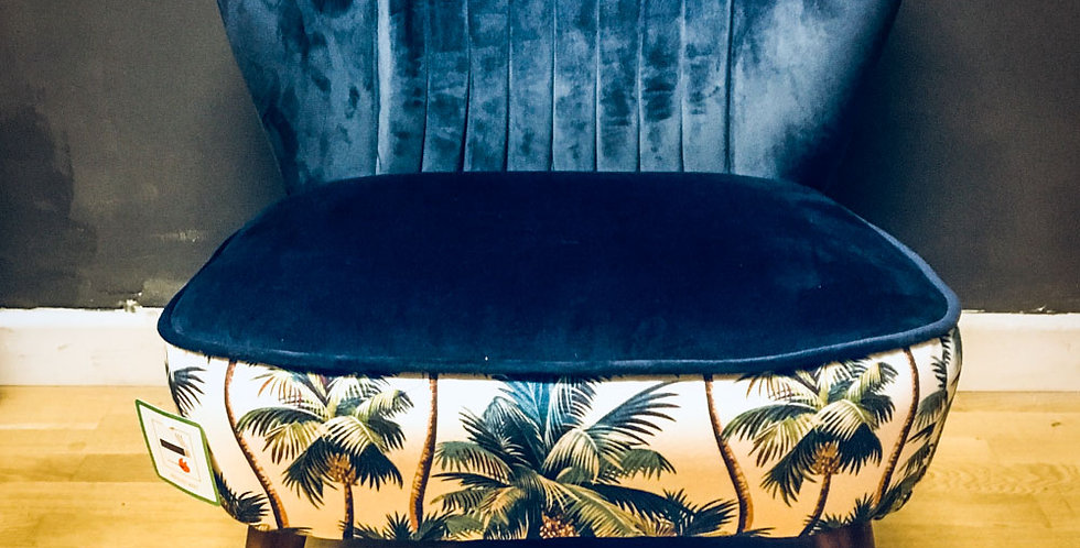 Velvet Blue cocktail chair with tropical print contrast.
