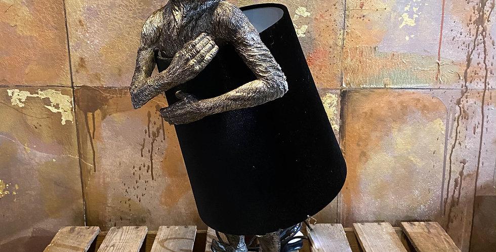 Silver Monkey lamp with black velvet shade