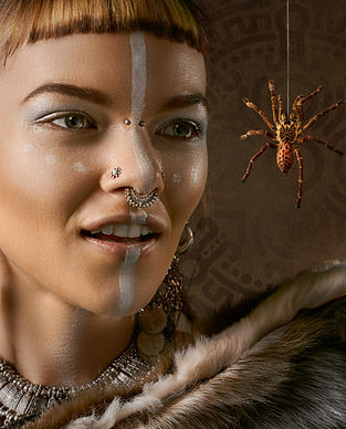A model indigenous face painting and a nose bridge piercing, nostril and an Indian-inspired septum piercing