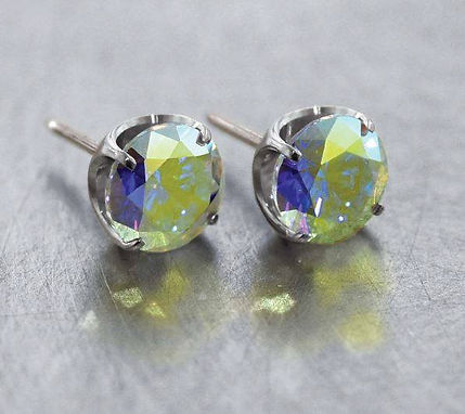Set of two threadless, sparkly studs in light green and blue by NeoMetal