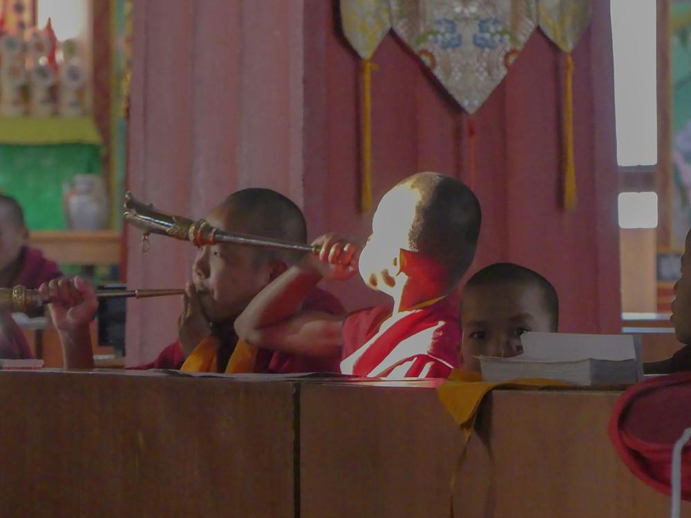 Musical little monks in Baktapur, Nepal. Visiting the Neydo Buddhist monastery.