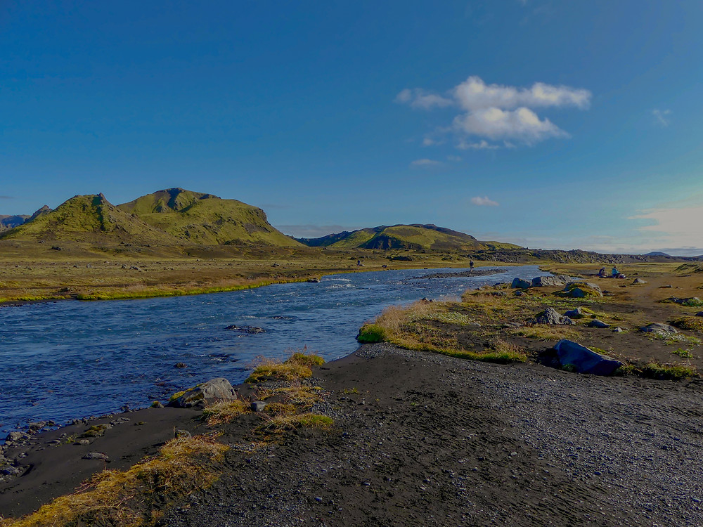 Crossing the river Bratthalskvisl on the Laugavegur Trail in Iceland.