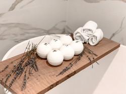 Six of PENN'S CHOICE Lavender CBD Bath Bombs with dried lavender over a spa tub in Pittsburgh