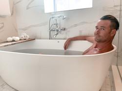 Steve of PENN'S CHOICE soaking in a CBD bath at the Kimpton Hotel Monaco Pittsburgh