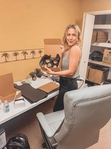 Rebecca wrapping CBD Bath Bombs at our old office