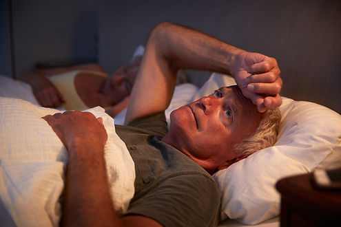 worried-senior-man-in-bed-at-night-suffe