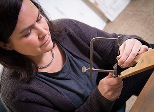 Morgan Saddington working in her studio