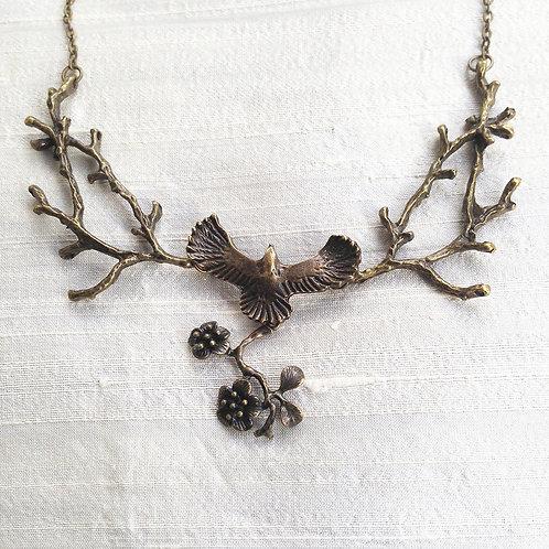 """FLYING BIRD WITH FLOWERS"" bronze"