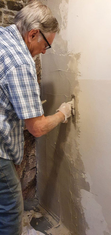 It's plastering Jim; but not as we know it!