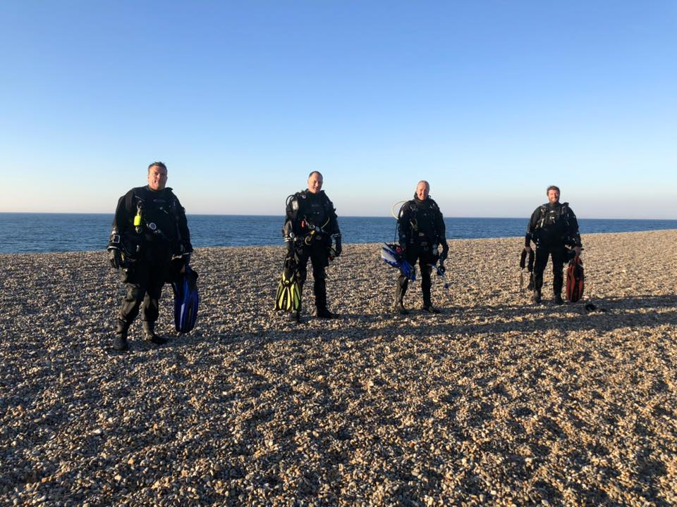 divers on weybourne beach