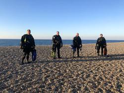 divers on weybourne beach