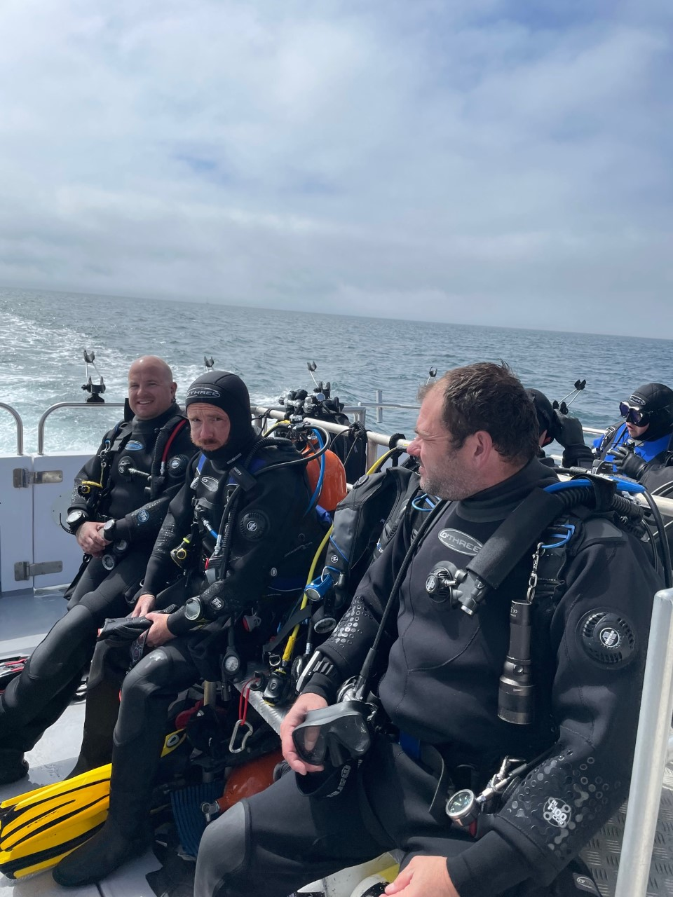 1.  divers on boat